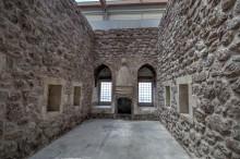 Ishak Pasha Palace - a room with a fireplace