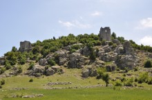 The hill of Olba Acropolis, with visible towers and fortification walls