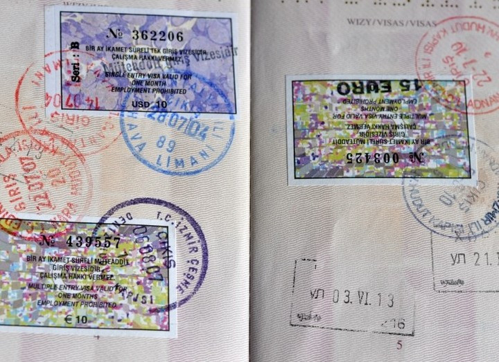 Traditional Turkish tourist visas stamped in a passport